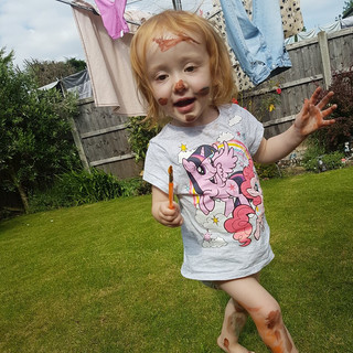 Aoife covered in paint!