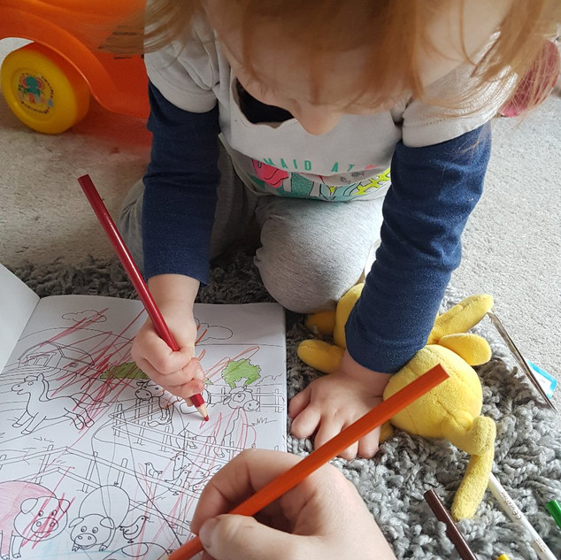 Aoife colouring with Mummy