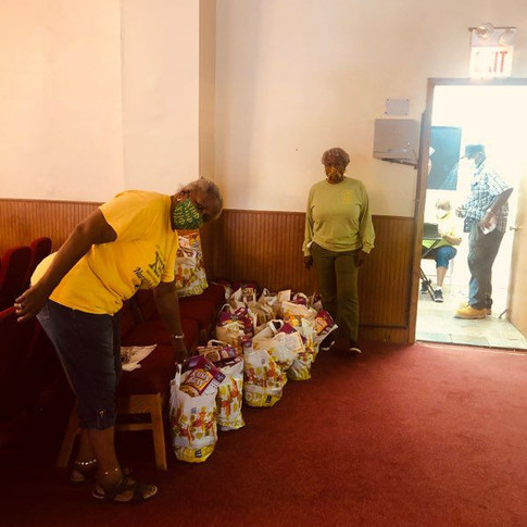 Constance Daniels and Jackie Smith replenishing bags.