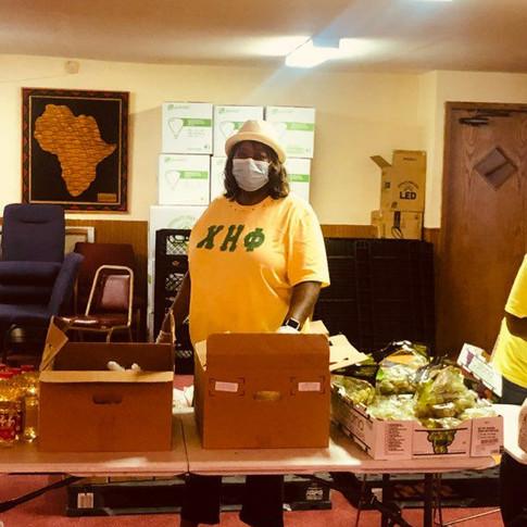 Doris Kelly organizing food for packing.