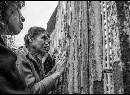 """No Touching"": Peering Through the Iron Bars of the US-Mexico Border, Families Struggle to"