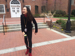 Taya Graham laughing at herself after messing up her stand up in the State Capitol