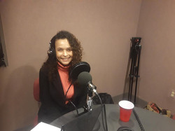 Taya M Graham recording Podcast.jpg