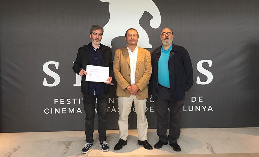 Francisco Guerrero, ganador del 24º Premio UPC de Ciencia Ficción, con el rector de la UPC, Francesc Torres, i Miquel Barceló, impulsor del galardón