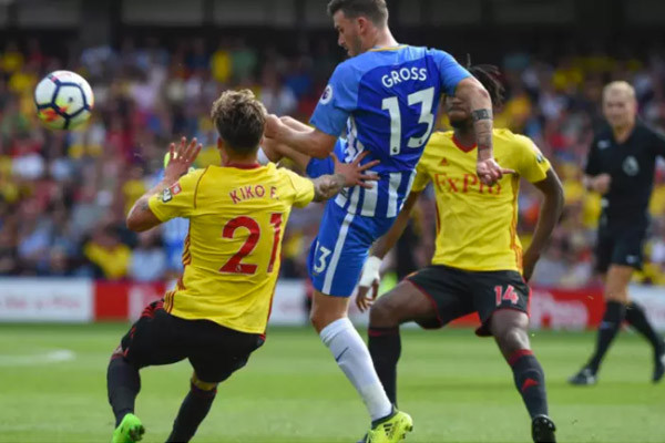 Brighton and Hove Albion playing football against Watford