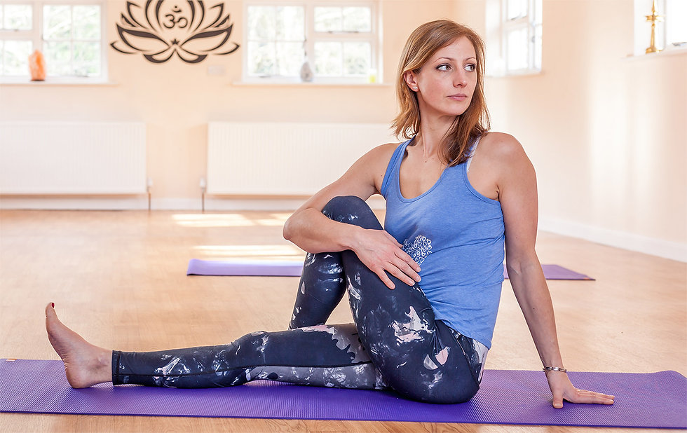 Kate Anderson in a yoga pose