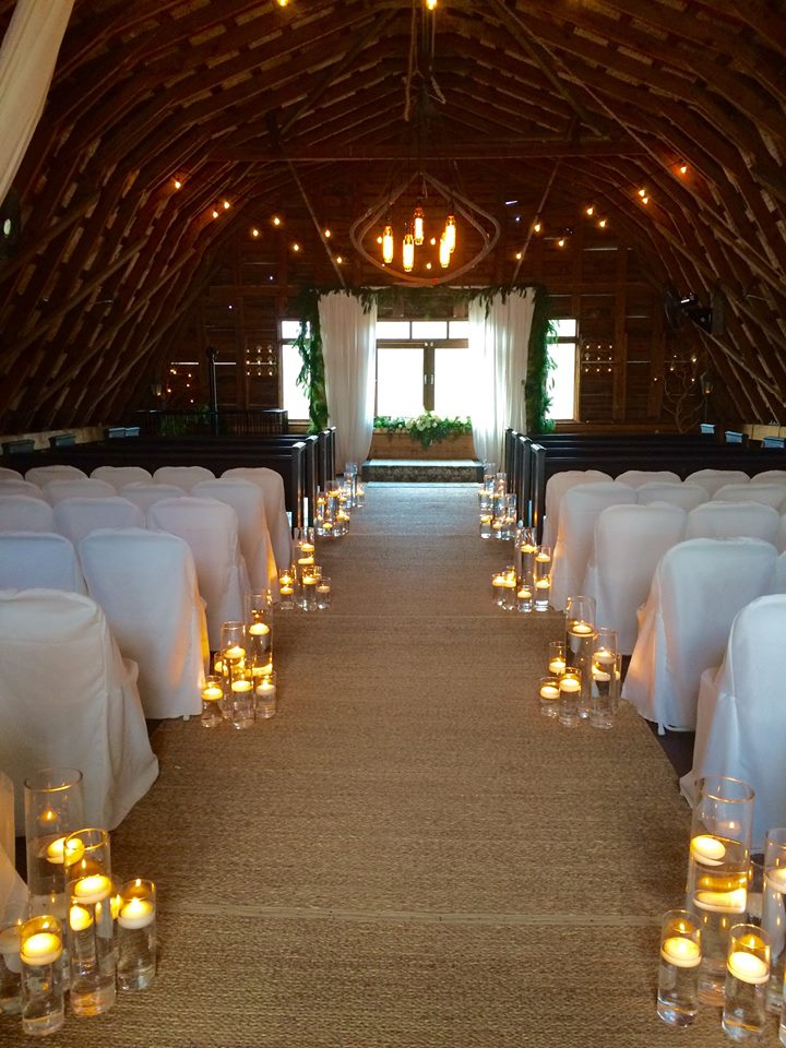 Indoor ceremony in their barn
