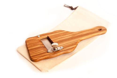 Mandoline à truffes en bois d'olivier avec sac en toile.