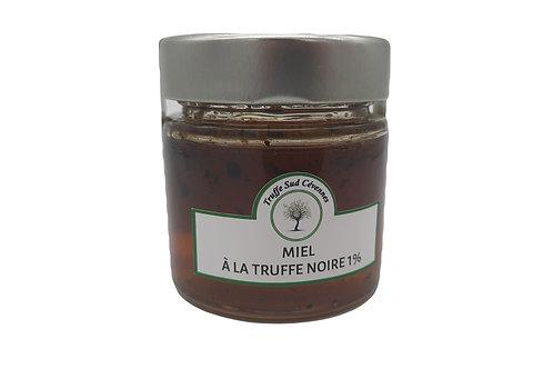 Miel d'acacia à la truffe noire vue de face.