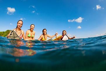 Happy girls in bikini have fun - group o