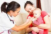 Pediatrician-checking-a-baby copy.jpg