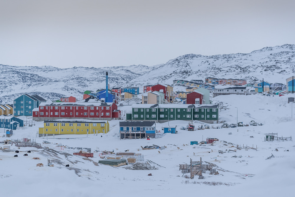 Also Illulisat in Greenland - the grey skies and indutrual looking buildings remind of Lowry paintings, only colourful.
