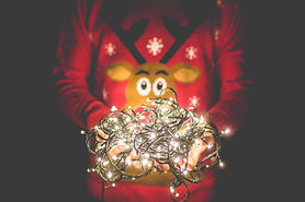 man-in-christmas-sweater-holding-christm