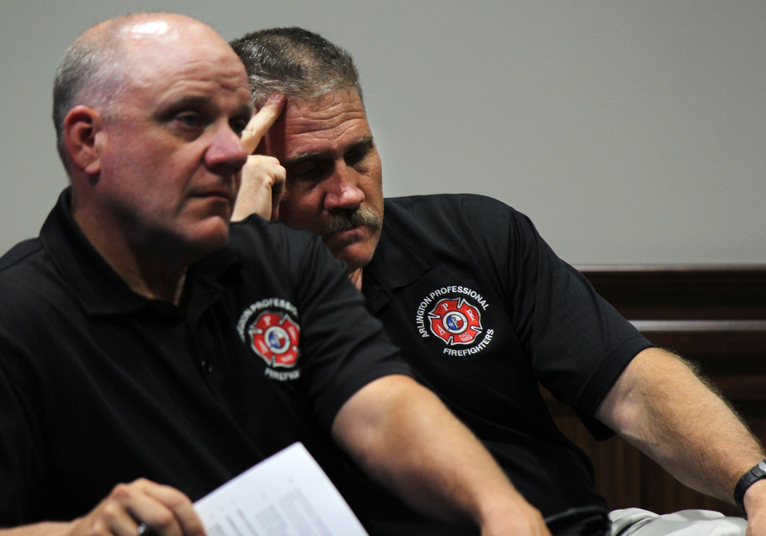 David Crow, right, Arlington Professional Firefighters president and Kevin Leverette, vice president, sit second row during the Oct. 17 City Council meeting to listen to discussion of an ordinance regarding fire departments, at Arlington City Hall. The ordinance would establish fire department civil service job classifications, special pay and sick and vacation leave for certain members in the department.