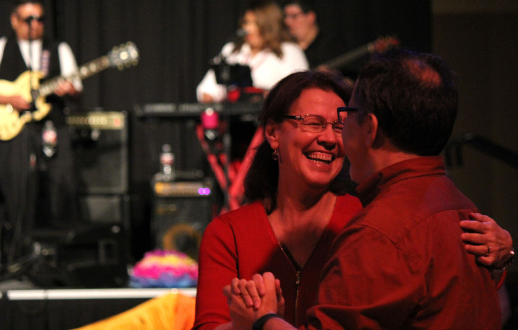 Husband and wife Minerva Cordero, College of Science associate dean, and mathematics professor James Alvarez dance together at the Hispanic Heritage Month Celebration on Sept. 28 in the University Center Bluebonnet Ballroom. The married couple attended Thursday night's event to support the Center for Mexican American Studies, celebrate the month and because they both like to dance, Alvarez said.