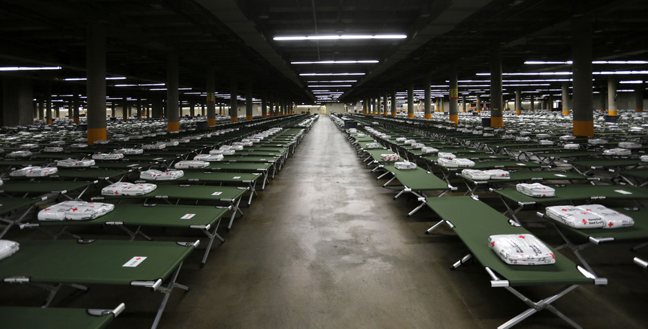 Cots provided by the American Red Cross lay organized in rows inside the Kay Bailey Hutchinson Convention Center on Aug. 28 for the 8:30 a.m. Tuesday arrival of Hurricane Harvey evacuees. The Monday morning set-up at the center will host more than 5,000 people.