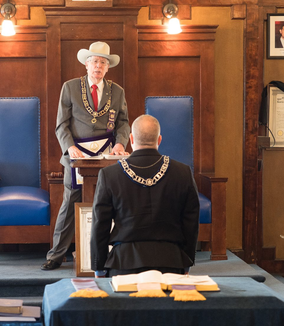 Past Grand Master Elmer Murphey III Installs Brother Tim Burke