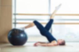 Pilates women with exercise ball at soundmovementny.com