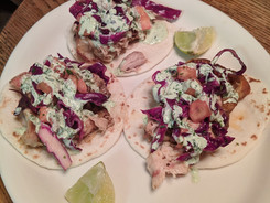 Chipotle Chicken Tinga Tacos with Grilled Pineapple Red Cabbage Slaw & Roasted Garlic Jalapeneo Lime Crema