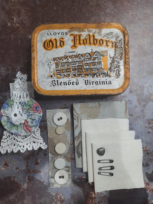 Blank fabric book in a tin