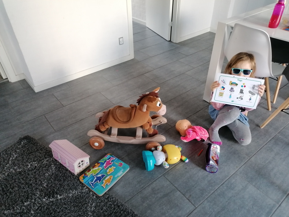 Imogen showcasing her toys after the toy hunt