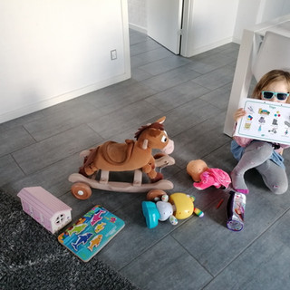 Imogen showcasing her toys after the toy