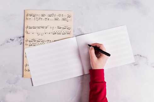 flat-lay-open-book-music-notes.jpg