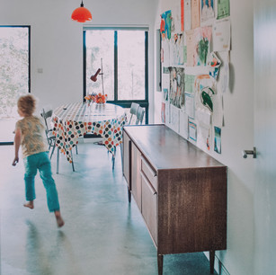 Polished concrete floor and retro mid century modern furniture and design