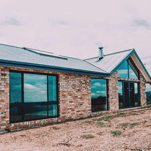 North facing country eco homestead with recycled brick façade