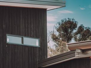 Charred hardwood cladding, and  horizontal bunker windows design inspiration