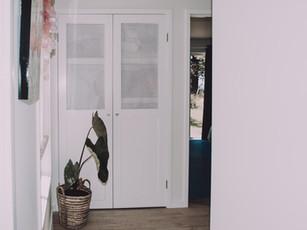 Renovated beach house linen closet storage solutions