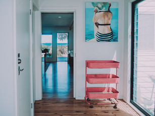 Renovated hardwood floor give a beach shack feel to the renovation