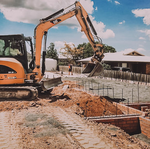 Earthworks and level block and footings
