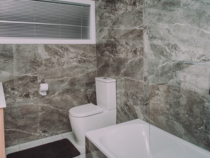 Floor to ceiling marble walls