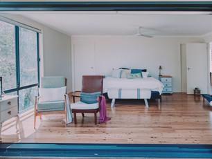 Stacker door inspiration best example in Master bedroom suite overlooking ocean