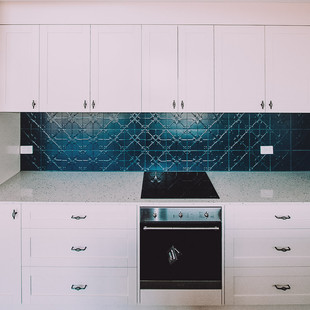 Rustic country kitchen design with pressed tin splashback