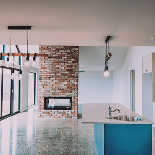 Solar passive design eco floor plan with polished concrete and recycled brick chimney