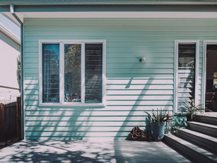 Louvered windows and weatherboard cladding