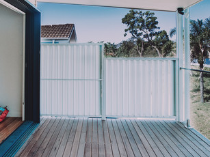 Privacy screen on external deck on coastal renovation