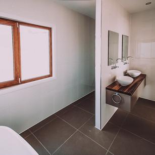 Large modern en suite design by sustainable designer PdD Building Design