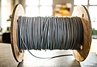 giant-skein-of-gray-wires-on-a-reel-in-m