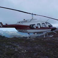 Flying to mountaintop site in Alaska.