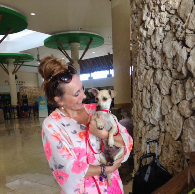 Trevioso with the beautiful Ana in Punta Cana on his way to Washington DC