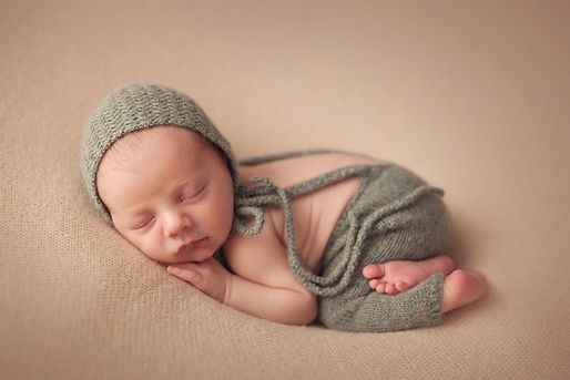 Sleeping newborn baby boy 10 day old.jpg