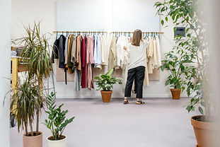 woman-fixing-clothes-on-the-rack-3965548