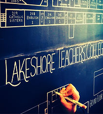 """Hand drawing floorplan with white pencil on blackboard. Words """"Lakeshore Teachers' College"""" appear above."""