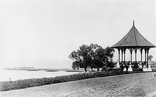 Black and white historic photograh of the former women's gazebo that once stood along the shoreline of Lake Ontario