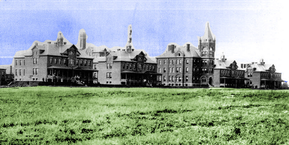 Historic view of five buildings from the Mimico Asylum edited so that the buildings remain in black and white but the grass in the foreground is green and the sky is purple