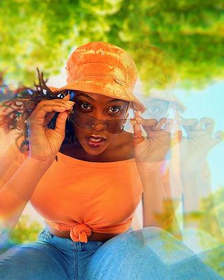 Bria The Artist Orange shirt and bucket