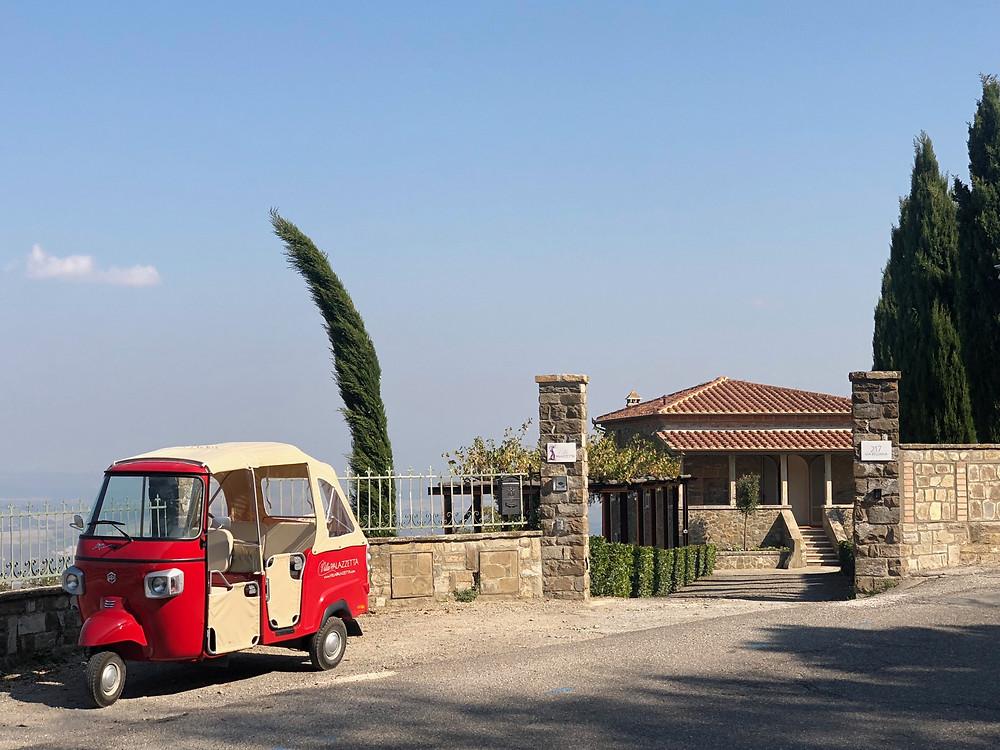 Villa Palazzetta and its little red Ape Calessino.